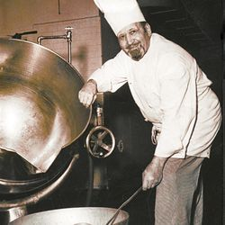 Tony Furano posing with the large kettles he used to make sauces and other dishes, in mass quantities, for the Hotel Utah restaurants.