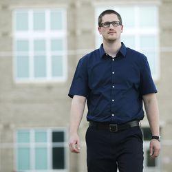 Former East High School teacher Andrew Platt walks near the school in Salt Lake City on Thursday, June 9, 2016. Platt recently resigned as a teacher and took a job with better pay, allowing him to pay off student loans.