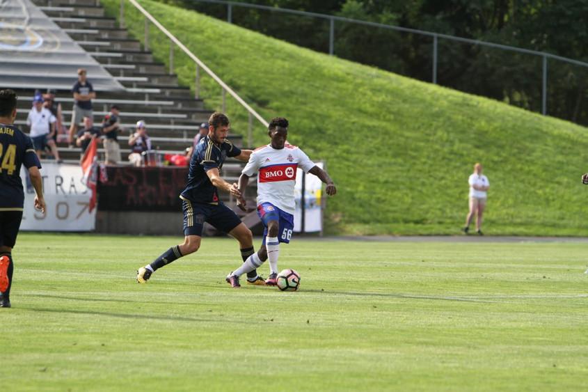 USL Photo - TFC II's Malik Johnson shield the ball from a Bethlehem defender in Toronto's 3-1 loss