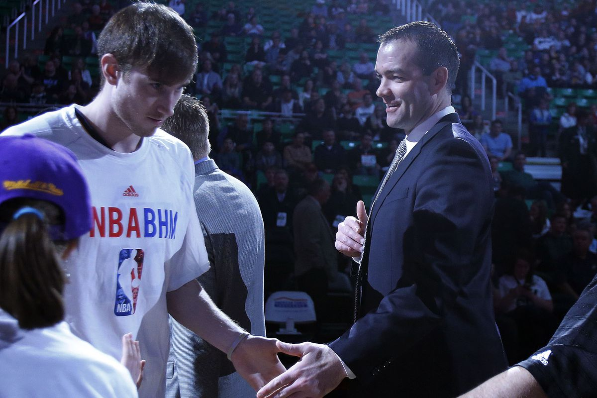 Alex Jensen slaps hands with Gordon Hayward (20) of the Utah Jazz as the Jazz's starting lineup is introduced in Salt Lake City, Monday, Feb. 3, 2014.