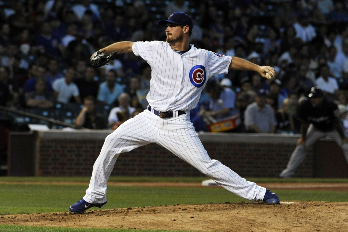 August 28, 2012; Chicago, IL, USA; Chicago Cubs starting pitcher Travis Wood (30) pitches against the Milwaukee Brewers in the second inning at Wrigley Field. Mandatory Credit: David Banks-US PRESSWIRE
