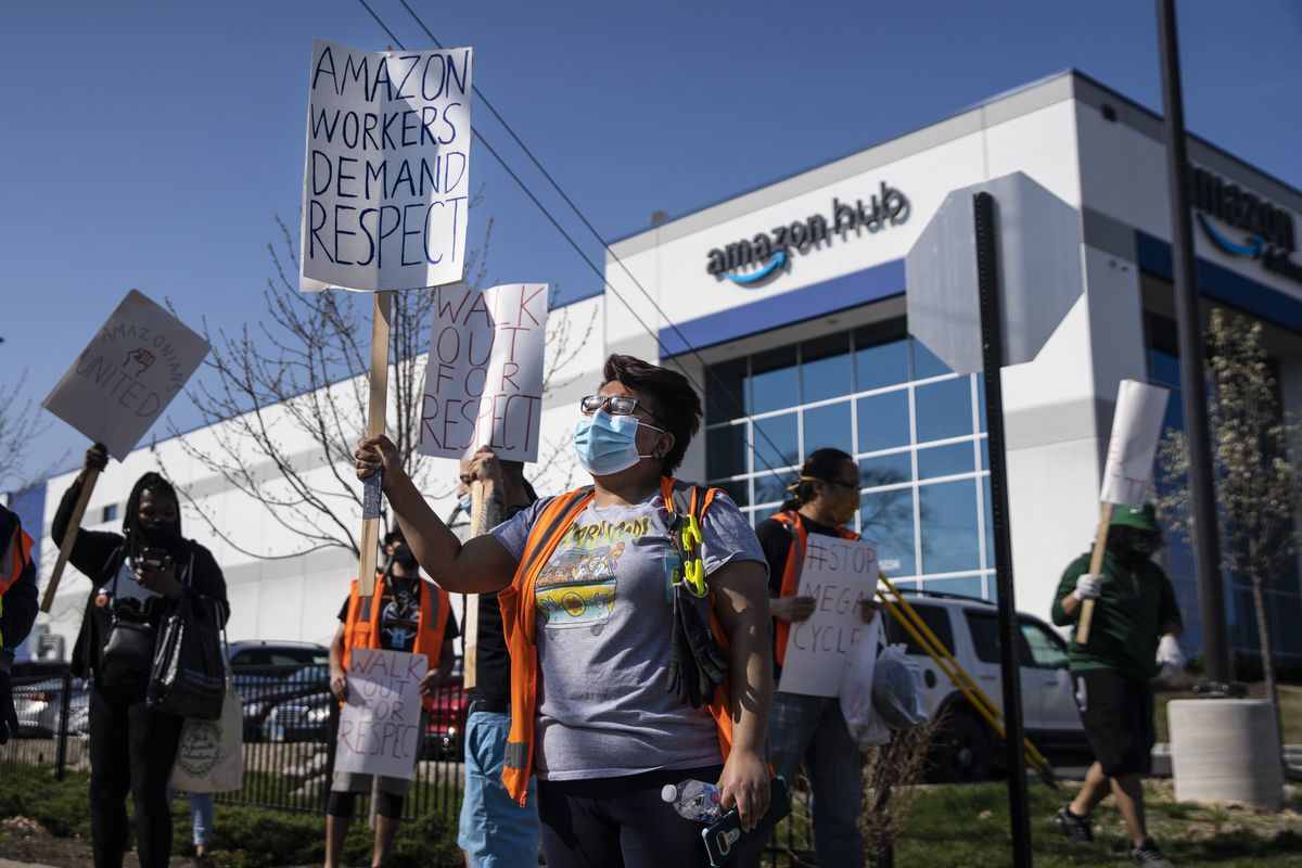 Vanessa Carillo Ruiz, 23, joins about a dozen fellow Amazon workers in a walkout and protest Wednesday, April 7, 2021 to demand better working conditions at the Amazon facility in Gage Park on the Southwest Side.