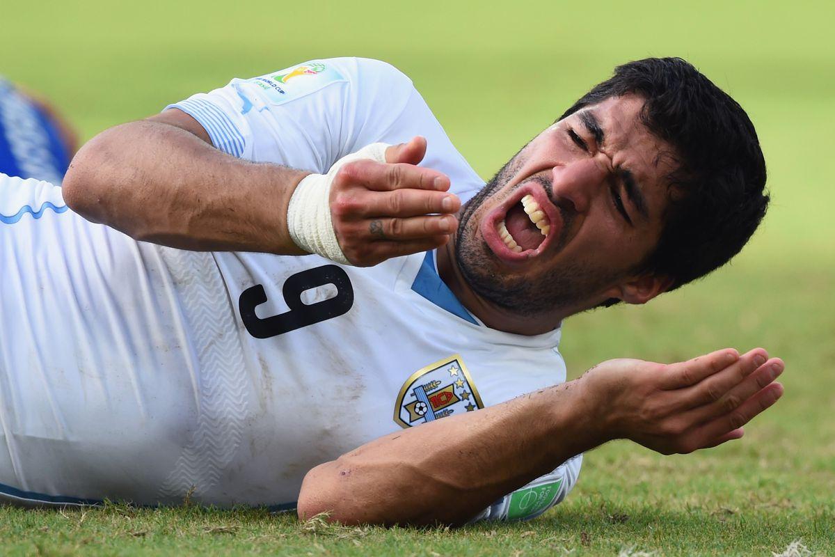 Suarez, after having had his teeth attacked by Giorgio Chiellini