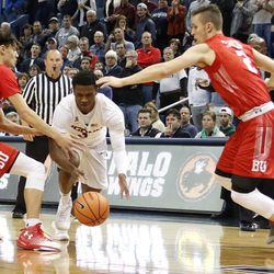 UConn's Alterique Gilbert (3) splits two Boston University defenders.
