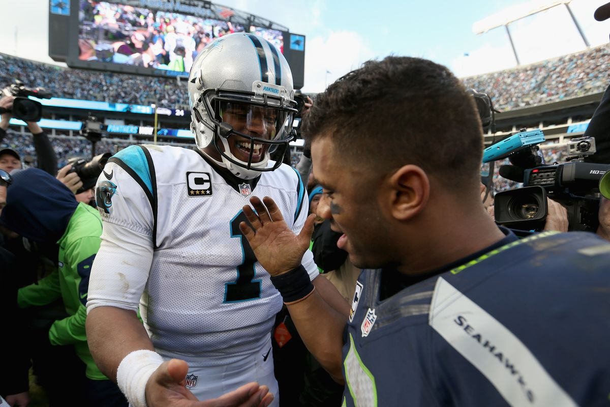 Cam Newton of the Carolina Panthers shakes hands with Russell Wilson of the Seattle Seahawks after the NFC Divisional Playoff Game at Bank of America Stadium on January 17, 2016 in Charlotte, North Carolina.