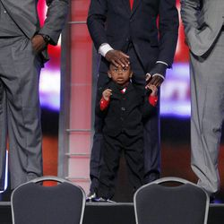 LSU cornerback Morris Claiborne, center, holds his son while posing for photographs before the NFL football draft at Radio City Music Hall, Thursday, April 26, 2012, in New York.