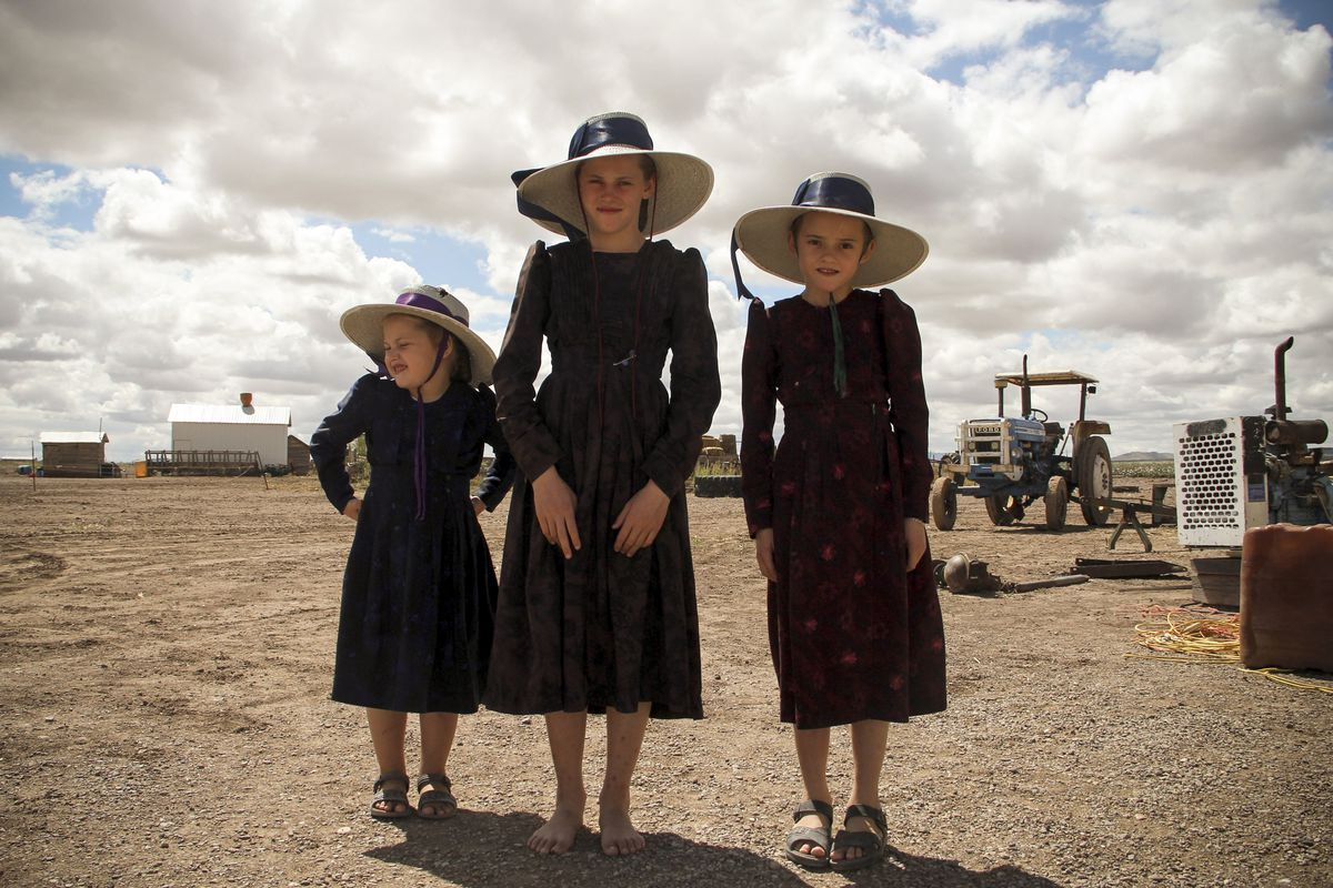 September 22: Mennonite girls from the Sabinal community, in the state of Chihuahua, Mexico. Isolated from technology and with horse-drawn carts as their only means of transportation, Sabinal's 1,500 Mennonites are divided as government installed power li