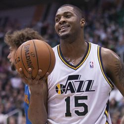 Utah's Derrick Favors smiles after being called for traveling as the Jazz and Hornets play Jan. 30 in Energy Solutions arena. The Jazz won 104-99.