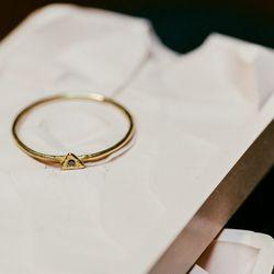 "The <a href=""http://odetteny.com/tiny-triangle-ring-14k-gold.html"">Tiny Triangle</a> ring in 14k gold and black diamond, $240"