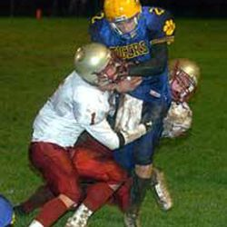 Tiger QB Nate Jones finds himself sandwiched by Bruin defenders Kyle Maag, left, and Kevin Chessman.