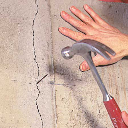 Hammering Nail In Crack For Injection Ports
