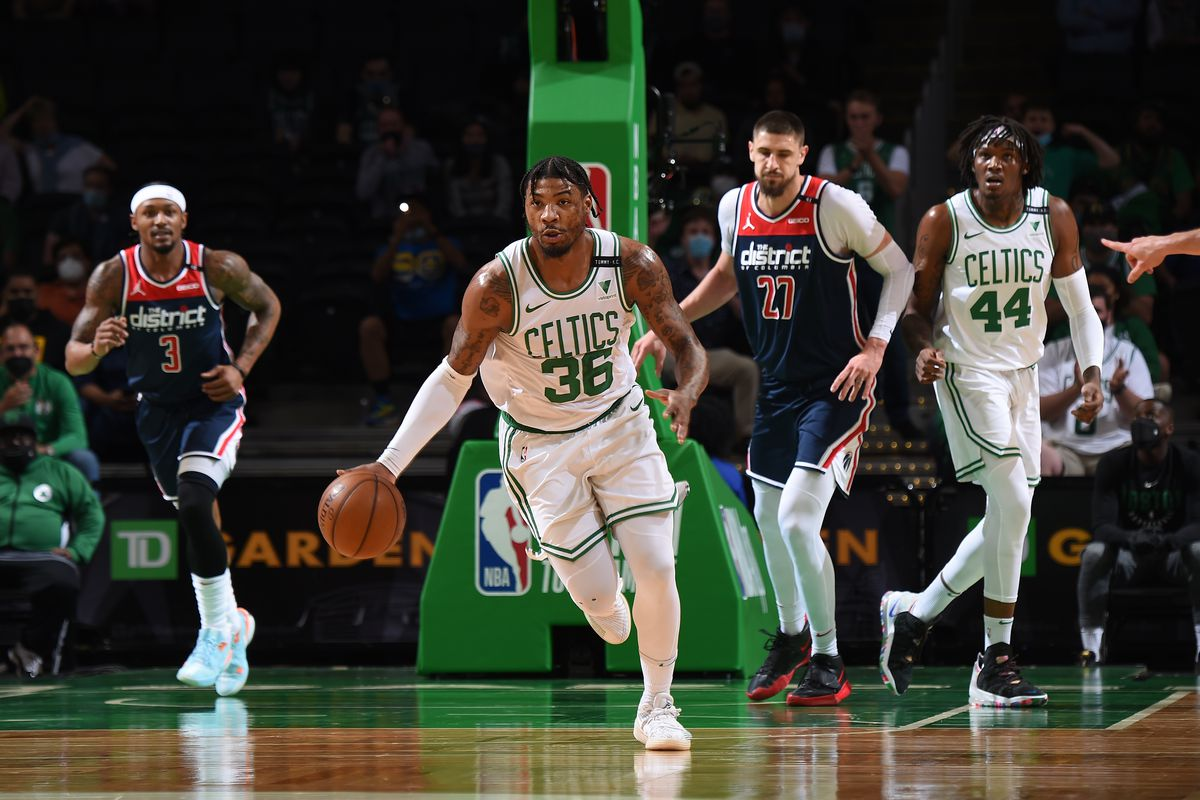 Marcus Smart of the Boston Celtics dribbles the ball during the game against the Washington Wizards during the 2021 NBA Play-In Tournament on May 18, 2021 at the TD Garden in Boston, Massachusetts.