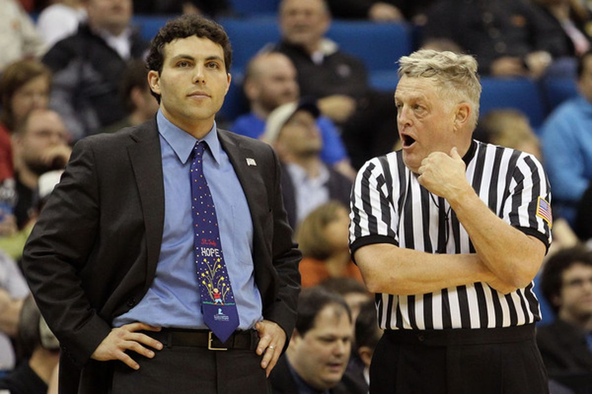 It's not often you see a coach blatantly ignoring a referee. BTW: Nice hair, Jim.
