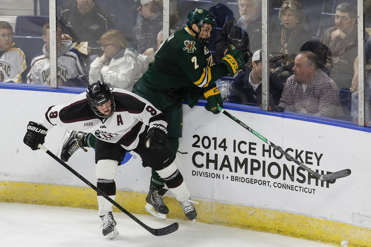 Union's Daniel Carr (9) and Vermont's Michael Paliotta (2) colide in Friday's NCAA East Regional.