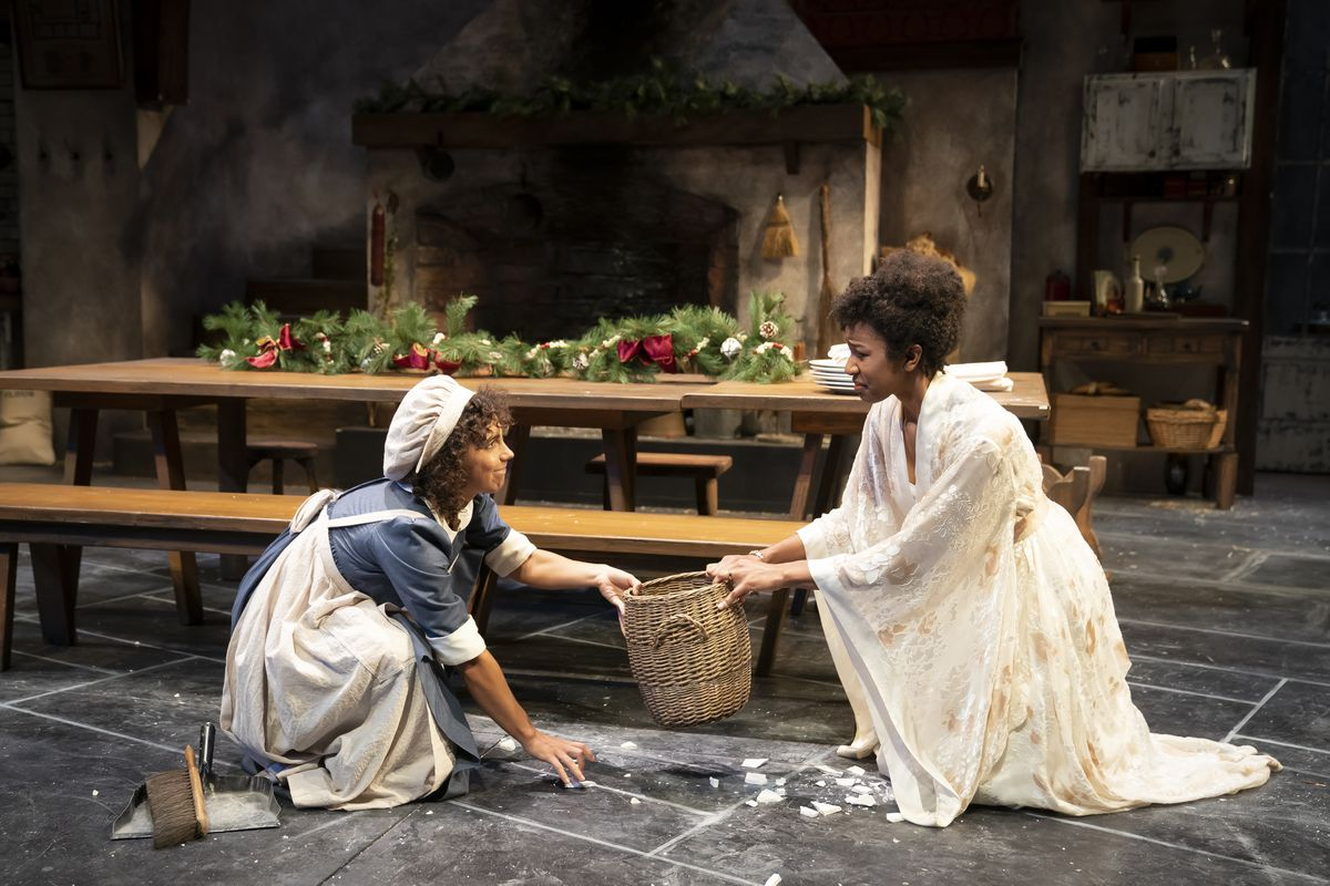 """Aurora Real de Asua stars as Cassie (left) and Jennifer Latimore stars as Lydia Wickham in """"The Wickhams: Christmas at Pemberley"""" at Northlight Theatre."""