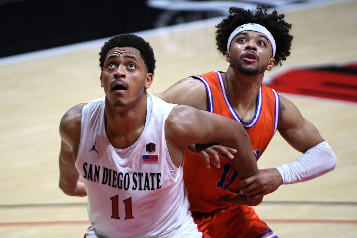 San Diego State Aztecs forward Matt Mitchell and Boise State Broncos guard Marcus Shaver Jr. battle for a rebound during the second half at Viejas Arena.