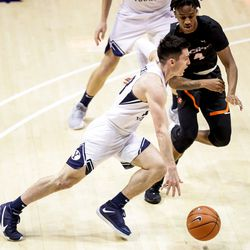 Brigham Young Cougars guard Alex Barcello (13) drives against Pacific Tigers guard Daniss Jenkins (4) at the Marriott Center in Provo on Saturday, Jan. 30, 2021.