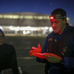 Lt. Robert Mitchell, air commander, goes over the preflight briefing before taking off from the Salt Lake City International Airport in Salt Lake City on Sunday, Feb. 12, 2017. The National Oceanic and Atmospheric Administration (NOAA) has been flying over Salt Lake, Cache and Utah valleys to survey chemical conditions responsible for the formation of particulate pollution, known as PM2.5.