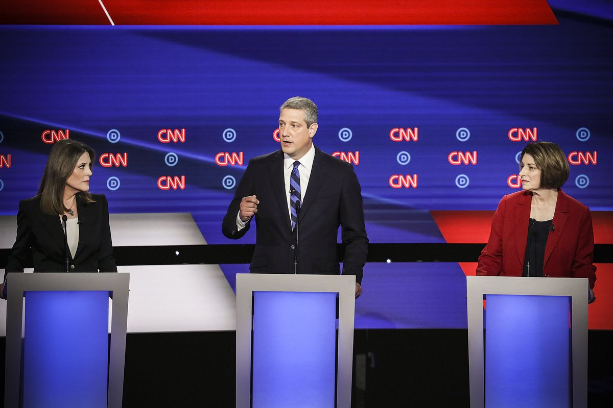 Democratic presidential candidate Rep. Tim Ryan (D-OH) speaks while Marianne Williamson (left) and Sen. Amy Klobuchar (D-MN) listen at the of the Democratic Presidential Debate on July 30, 2019 in Detroit, Michigan.