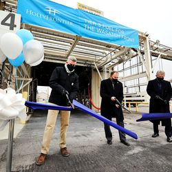 Scott White, HollyFrontier vice presidentand refinery manager, left, Gov. Gary Herbert and Mike Jennings, HollyFrontier president and CEO, cut a ribbon on Friday, Dec. 11, 2020,commemorating Tier 3 fuel being shipped from the Woods Cross refinery to customers along the Wasatch Front.