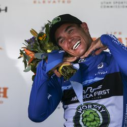 """Worthy Pro Cycling rider Travis Mccabe poses for photos after accepting his """"Fans Favorite"""" jersey during Stage 3 of the Tour of Utah at Eaglewood Golf Course in North Salt Lake on Thursday, Aug. 15, 2019."""