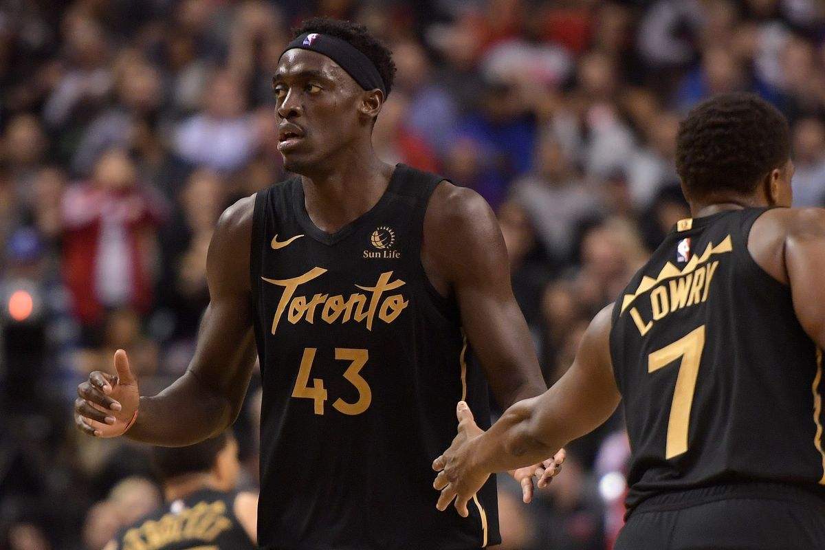 Toronto Raptors forward Pascal Siakam slaps hands with guard Kyle Lowry after making a basket against the Phoenix Suns in the second half at Scotiabank Arena.