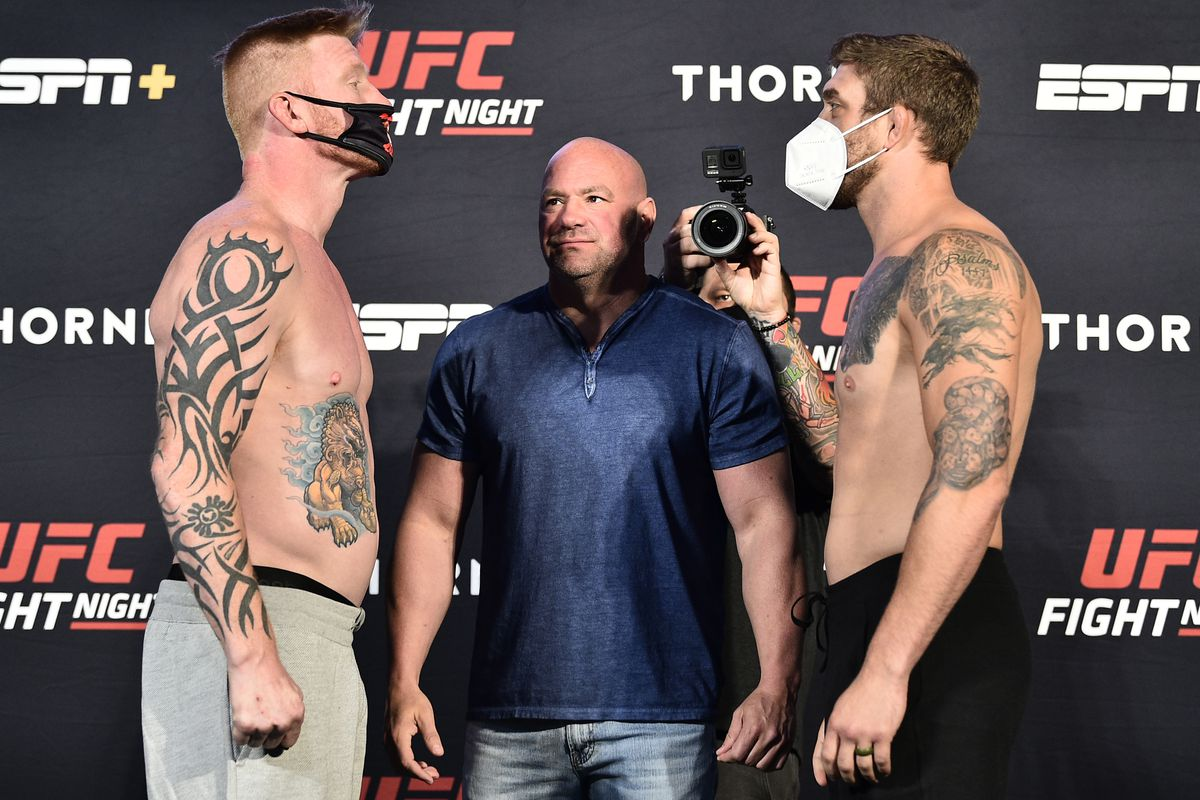 Opponents Ed Herman and Gerald Meerschaert face off during the UFC Fight Night weigh-in at UFC APEX on July 31, 2020 in Las Vegas, Nevada.