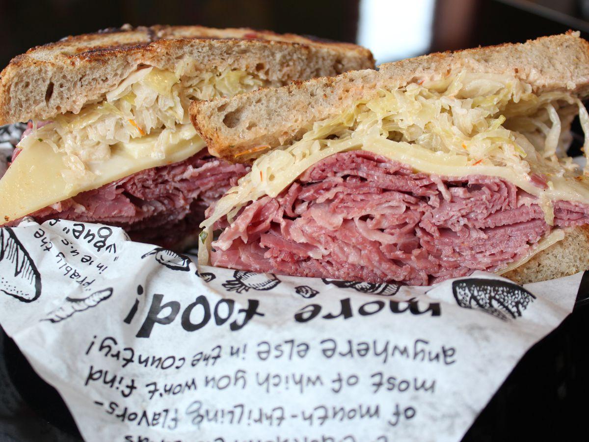 A massive Reuben sandwich from Zingerman's sits in a basket sliced in half.