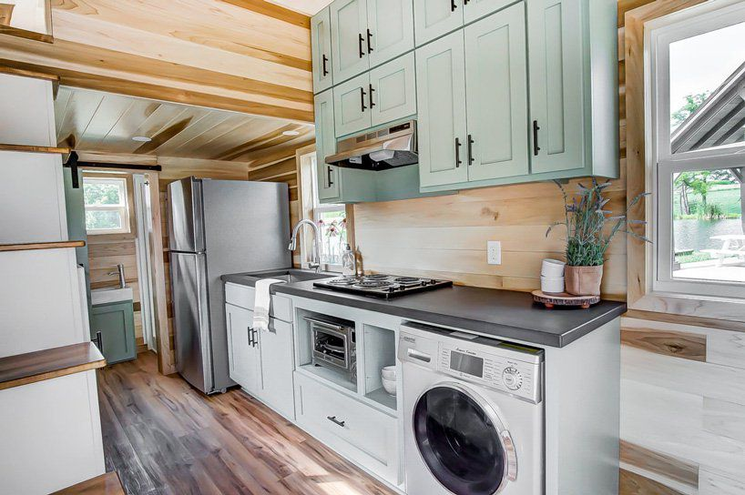 Kitchenette in tiny home with washer