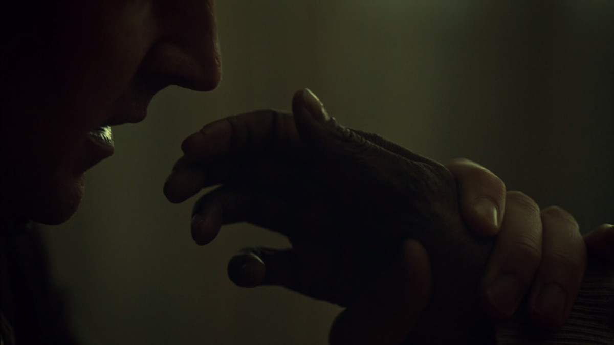 Francis stops Reba from touching his face on Hannibal.