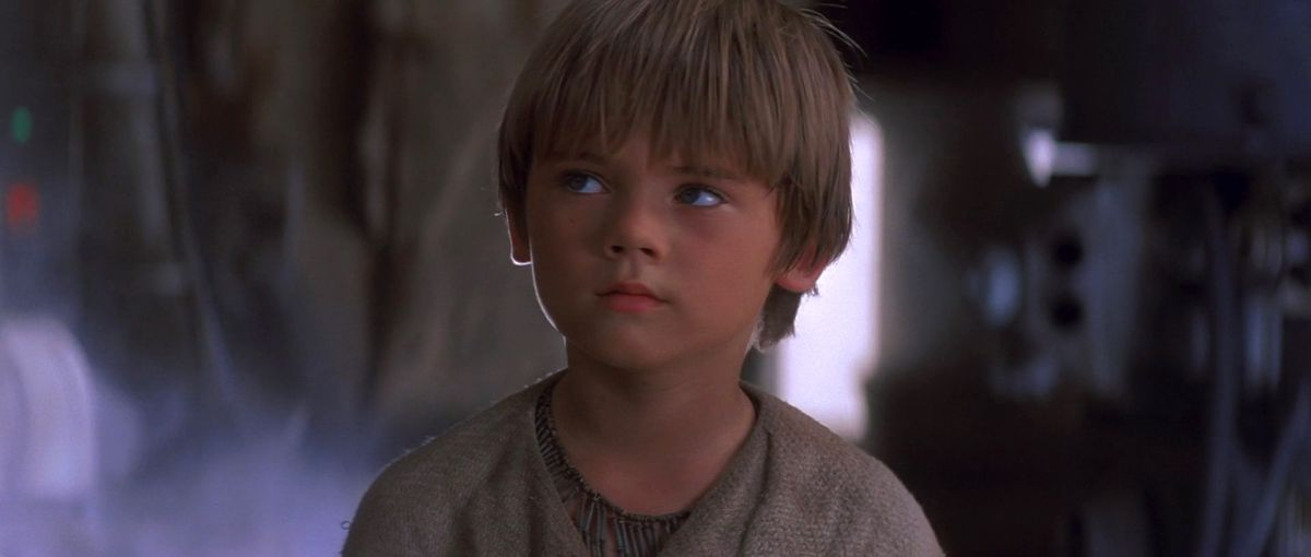young anakin skywalker gives side eye in phantom menace