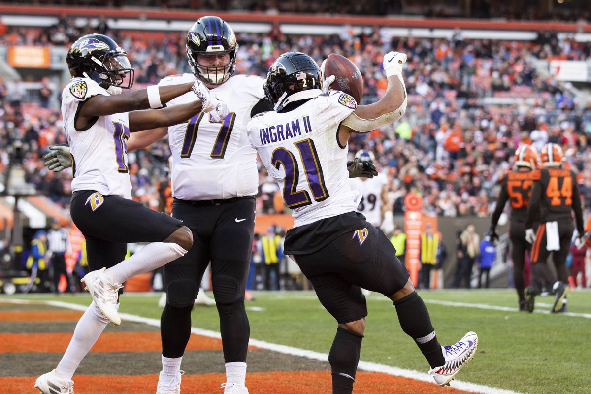 Baltimore Ravens running back Mark Ingram celebrates his touchdown with wide receiver Marquise Brown and offensive guard Bradley Bozeman during the third quarter against the Cleveland Browns at FirstEnergy Stadium.