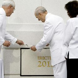 Elder Russell M. Nelson and his wife, Wendy Watson Nelson at right take their turns at putting mortar around the cornerstone. About 200 take part in the cornerstone ceremony at the Brigham City Temple prior to the dedication Sunday, Sept. 23, 2012.