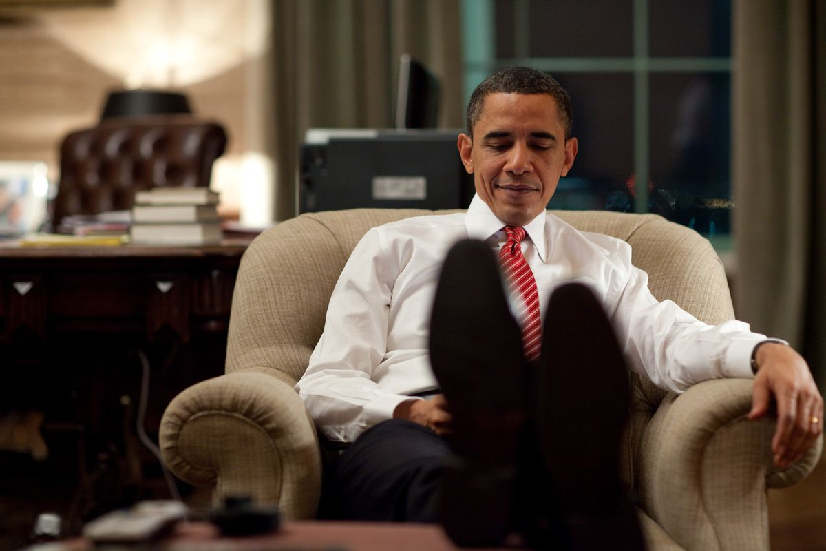President Barack Obama relaxes.