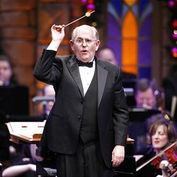 Conductor Mack Wilberg leads the choir as the Mormon Tabernacle Choir, singer Natalie Cole and author David McCullough perform at the annual Christmas concert at the Conference Center in Salt Lake Friday.