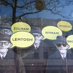 Founder Hyman Moscot calls out the names of various styles.