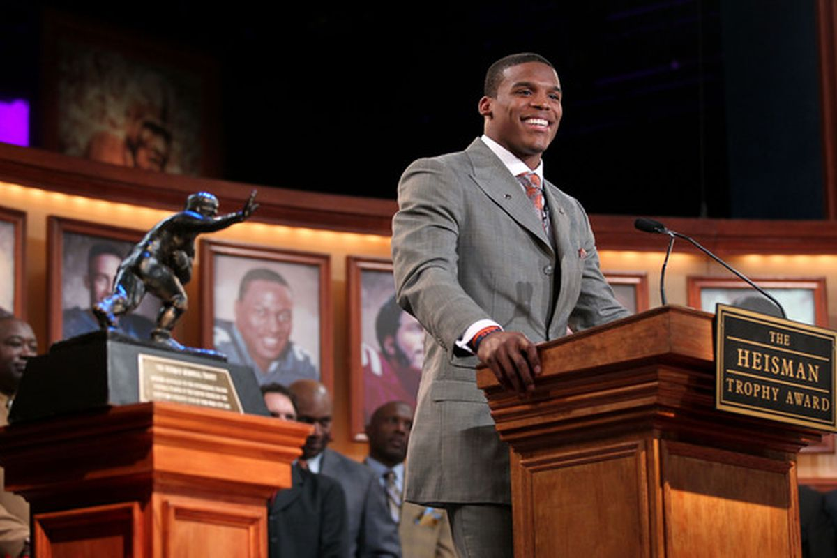 ... And the 2010 Heisman Trophy winner is... Cameron Newton, <strike>Auburn University</strike> Mississippi State NO AUBURN BACK OFF HE'S OURS THIS TIME (Photo by Kelly Kline/Getty Images for The Heisman)
