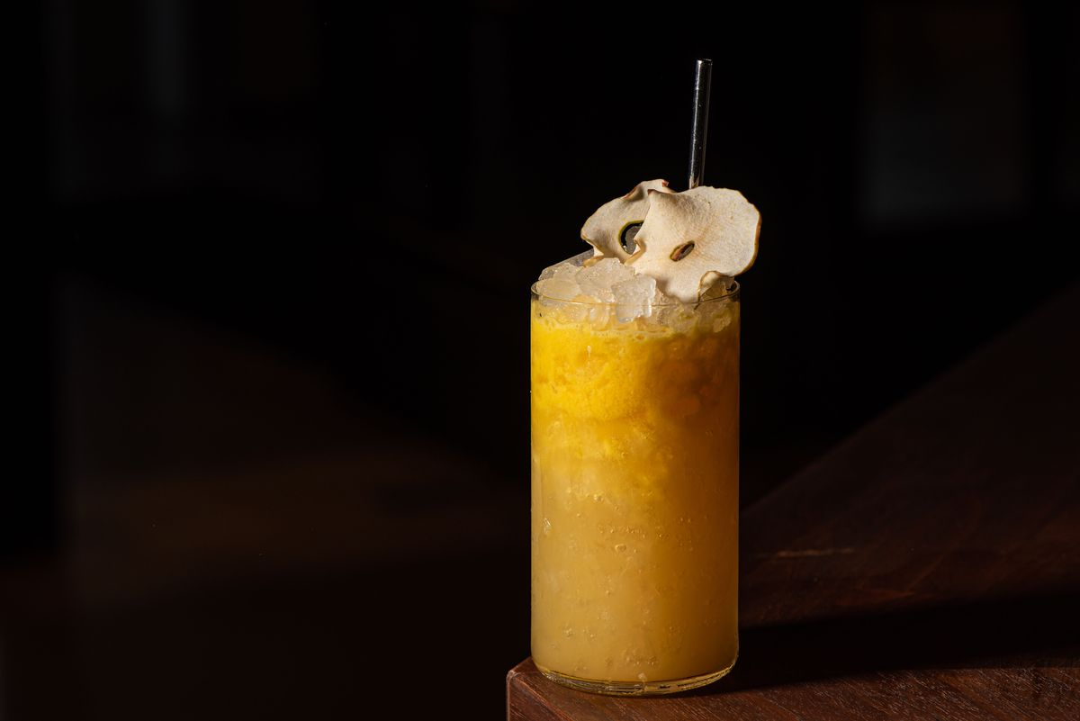 """Run the Jules cocktail with kumquat, capertif verjus blanc, bourbon, crushed ice, """"Fluffy orange"""" in a glass."""