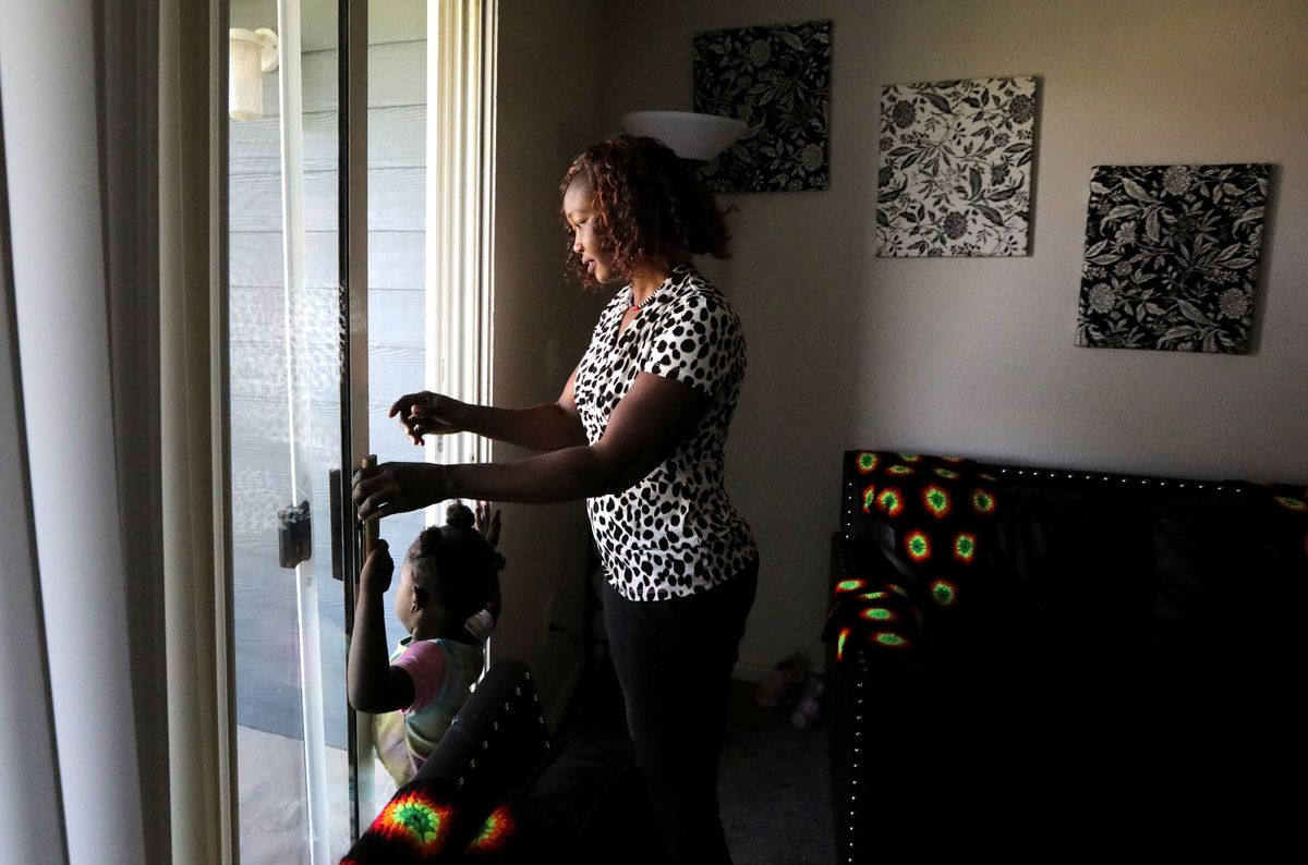 Tabitha Kwayge, a Sudanese refugee, anddaughter Siyanna Inna walk out to a deck from their apartment in Midvale on Wednesday, Sept. 15, 2021. Kwayge is looking for another place for her family to live as the $1,500 monthly rent is too expensive.