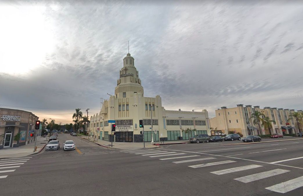 The exterior of the Scientology Inglewood community center in Los Angeles. The facade is tan and there is a tower on top of the building.