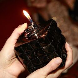 Corona's line focuses on handbags, but she recently branched out into housewares. Included: this insane tabletop lighter, intended to ignite candles.