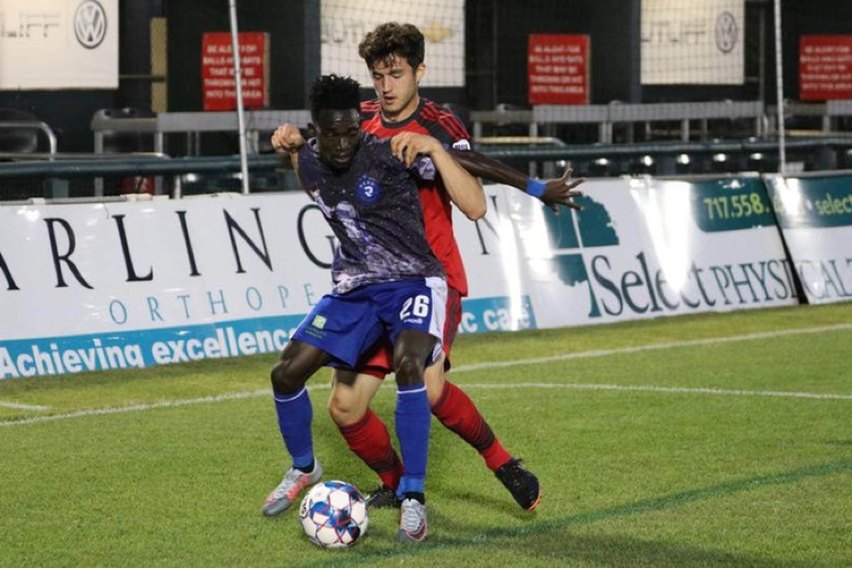 USL - Photo Toronto FC II's Matt Srbely battles in midfield against Penn FC