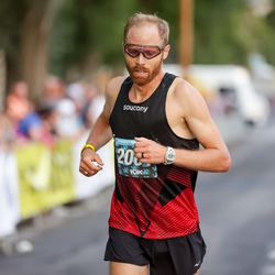 Jared Ward finishes second in the men's division of the Deseret News 10K at Liberty Park in Salt Lake City on Friday, July 23, 2021.