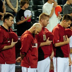 Diamondbacks observe a moment of silence before their game against the Brewers at Chase Field