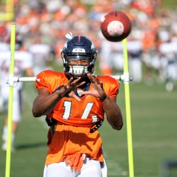 Broncos rookie WR Courtland Sutton looks to receive a pass during position drills.