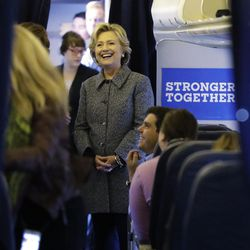 Democratic presidential candidate Hillary Clinton meets with her staff before taking off on her campaign plane at Westchester County Airport in White Plains, N.Y., Thursday, Sept. 29, 2016.