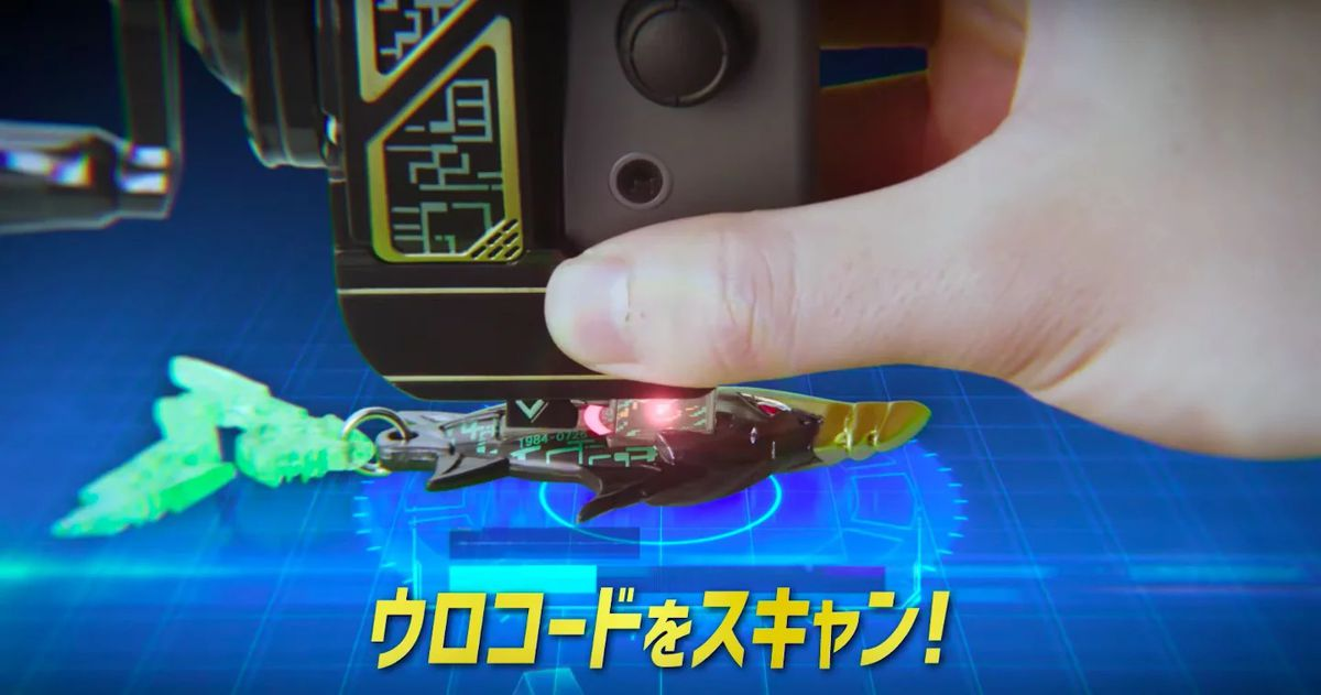 a fishing lure toy is scanned into a video game using the IR blaster on a Nintendo Switch Joy-Con