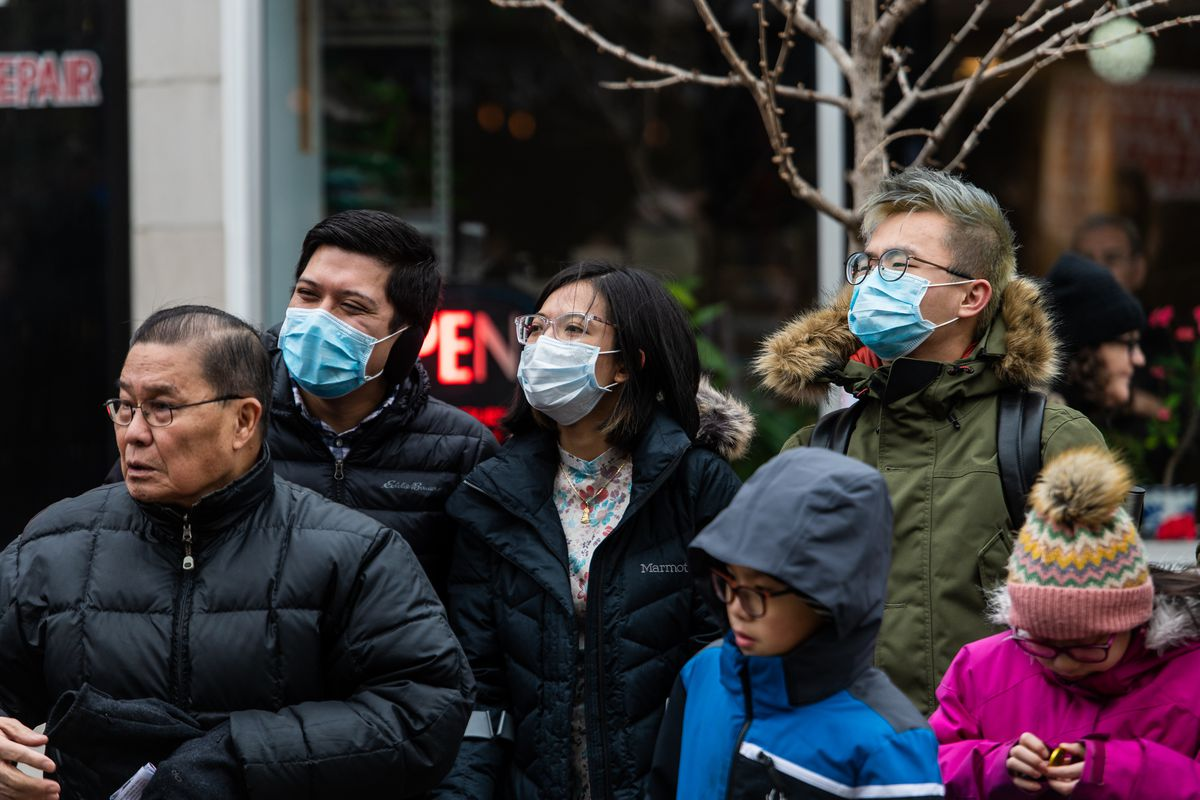 Jason Che (upper right) wore a face mask to the Argyle Lunar New Year Parade on Saturday as a precaution while the coronavirus has started to spread in the U.S.