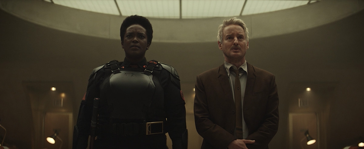 Hunter B-15 and Mobius stare at what the Lokis have wrought at the end of the season finale of Loki