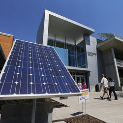 A solar panel gathers energy and raises awareness for energy conservation at the entrance to the Shepherd Union Building at Weber State University in Ogden on Friday, Aug. 19, 2016.